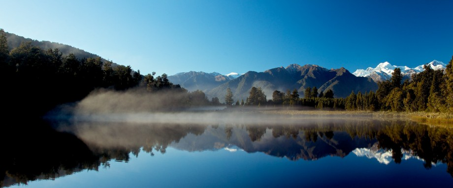 Images of Fox photo gallery shows Lake Matheson with sun and morning mist