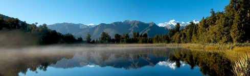 panoramic view of Lake Matheson mist in the early morning sun in autumn