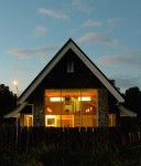 The lit up church viewed from the Southern Alps end of the building at dusk