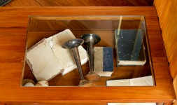 The church artefacts displayed in the entertainment cabinet