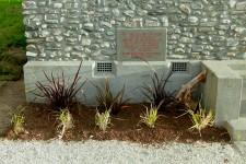 Front garden plants and memorial plaque