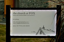 The sign for The Church at FOX fully lit up